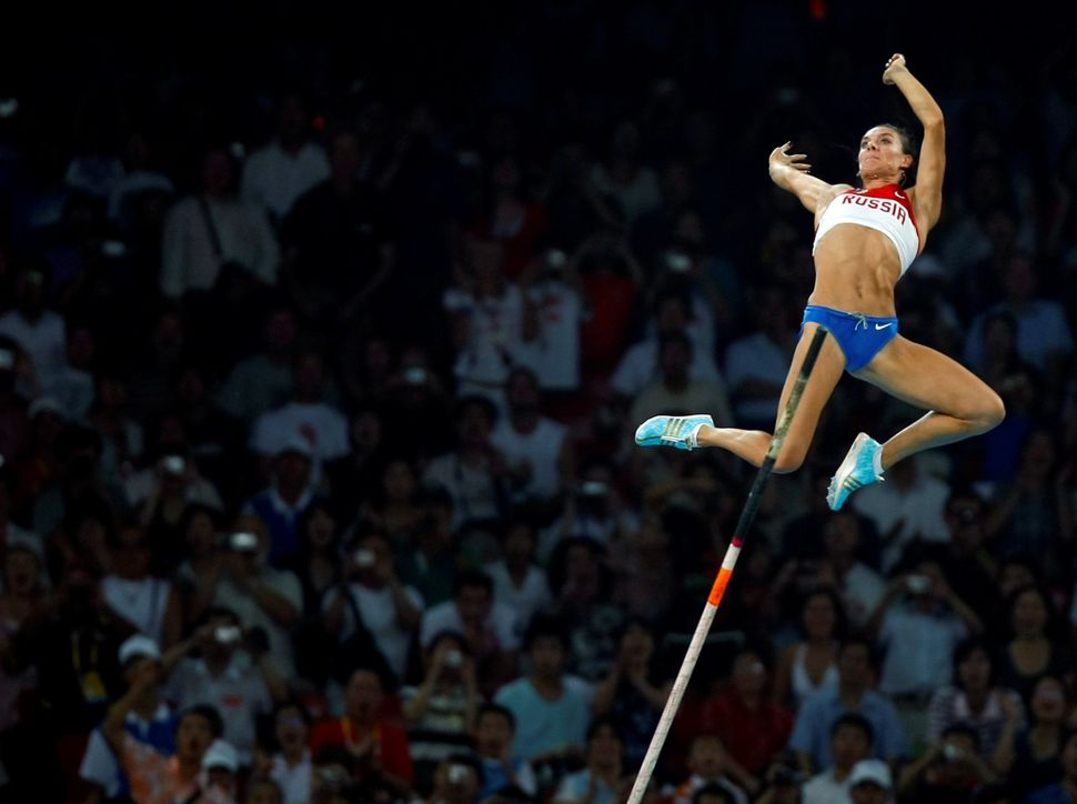ARussianpole vaulter at the 2008 Olympic Games in Beijing, China.