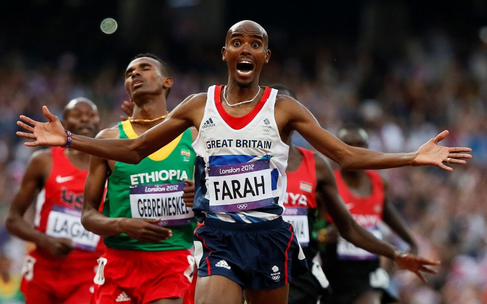 Britain's Mo Farah reacts as he wins goldat the London 2012 Olympic Games.