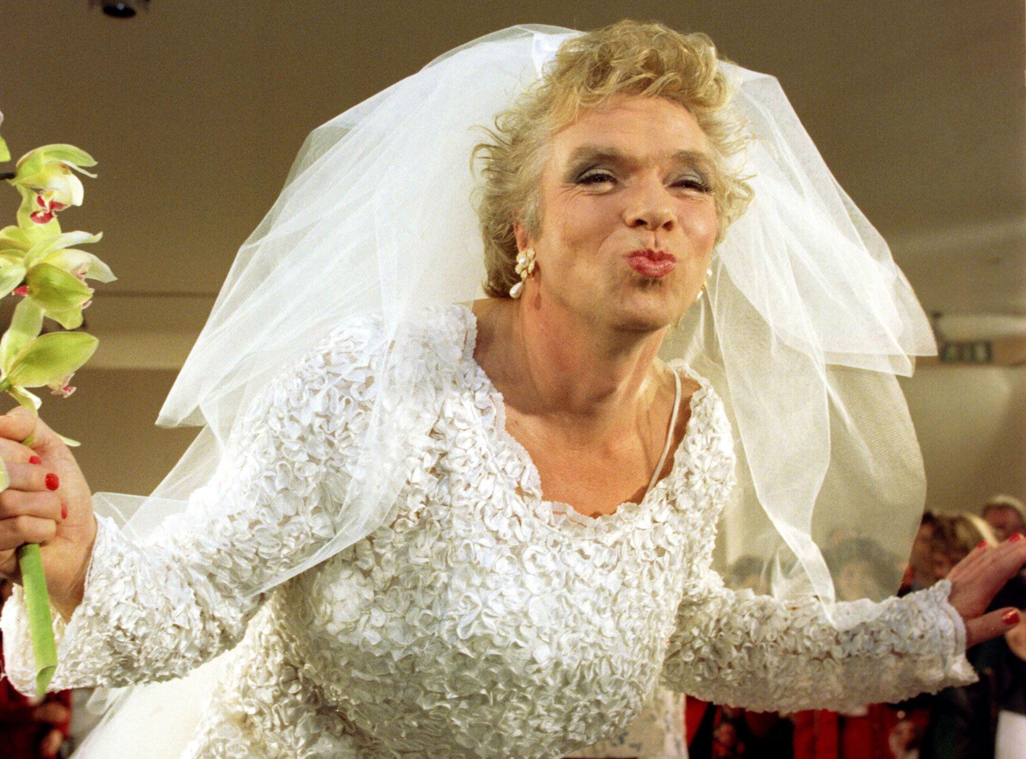 """Entrepreneur Richard Branson goes all out to promote his new business venture """"Virgin Bride"""" during its launch December 3. Branson, who shaved his beard for the big event, said his bridal retailing business will revolutionise the wedding industry in the UK."""