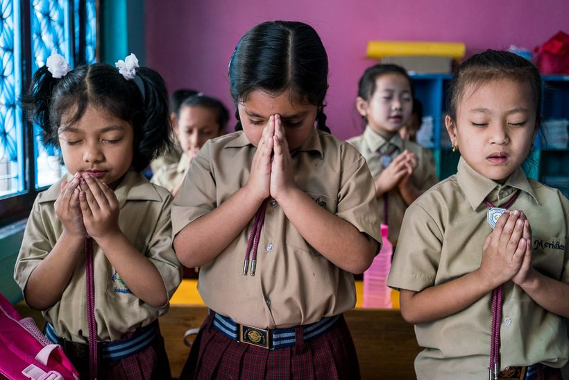 <i>Morning prayer at the Meridian International School, one of the most diverse, progressive, and high achieving schools in K