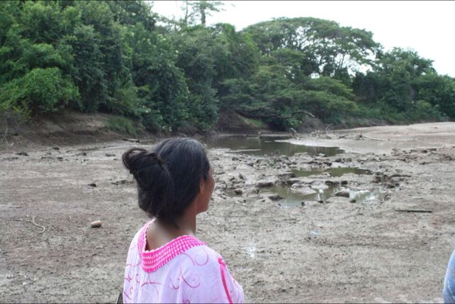 Wayuu Leader & Human Rights Defender, Matilde López Arpushana,<br>looks out upon The Rancheria River -- nearly dry