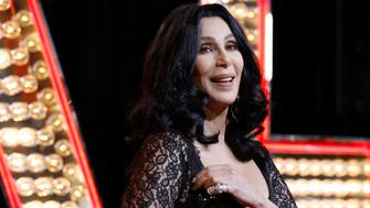 """Cast member Cher poses at the premiere of """"Burlesque"""" at the Grauman's Chinese theatre in Hollywood, California November 15, 2010. The movie opens in the U.S. on November 24.   REUTERS/Mario Anzuoni(UNITED STATES - Tags: ENTERTAINMENT)"""