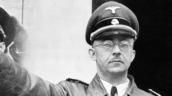 "FILE - The undated file photo shows German Nazi party official and head of the SS, Heinrich Himmler. at unknown location in Germany. German newspaper Welt am Sonntag has published a trove of letters believed to be written by Nazi SS leader Heinrich Himmler. On seven full pages the paper on Sunday Jan. 26,2014 showed pictures of Himmler and his family smiling into the camera during a fishing trip, the top Nazi taking a bath in a lake or feeding a little fawn. The newspaper, which says the material is contained in an eight-part series it plans to publish, also quotes excerpts from Himmler's love letters addressing his wife as ""my sweet, beloved little woman."" Welt said it worked together with Israeli film director Vanessa Lapa, whose family had the documents in its possession. (AP Photo/str/file)"