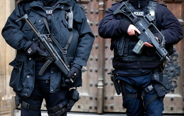 Armed police officers stand guard at the Houses of Parliament in