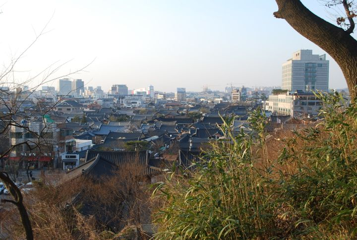 <p><strong>Jeonju Hanok Village | </strong>This village, made up of 800 traditional Korean houses (called <em>hanoks</em>), sits in the middle of one of its historically most important cities. Jeonju was once the capital of the Hubaekje Kingdom and was considered a spiritual capital of the Joseon dynasty (which was responsible for most of the Korean culture we know today). This village reflects that role, and it's easy to get lost roaming around the houses and among traditionally dressed couples. You can even sleep over at one of the many hanok-stays. Just make sure you eat some bibimbap while you're there -- Korea's national dish hails from it.</p>