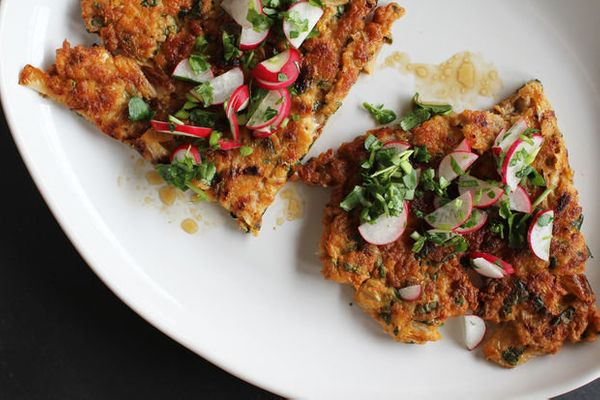 "<strong>Get the <a href=""http://food52.com/recipes/21696-kimchi-pork-scallion-pancake-with-watercress-radish-relish"" target="""