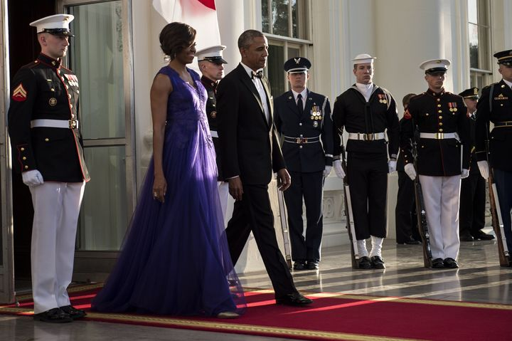 A purple gown by American-based Japanese designer Tadashi Shoji for the 2015 White House state dinner for Japanese Prime Minister Shinzo Abe.