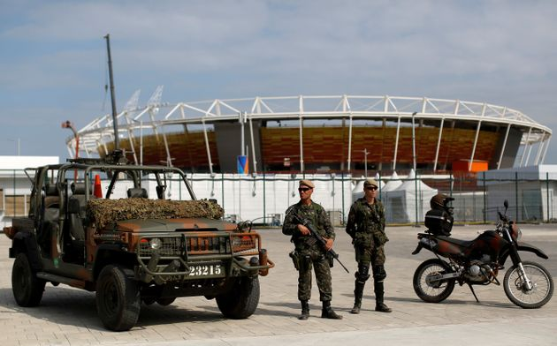 Brazilian Army soldiers patrol in front of the Olympic park ahead of the 2016 Rio Olympics in Rio de