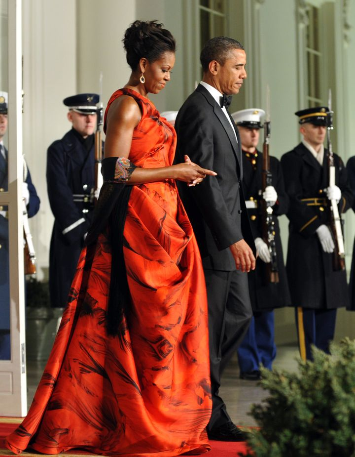 Wearing a red gown by Sarah Burton for Alexander McQueen at a 2011 state dinner for Chinese President Hu Jintao.