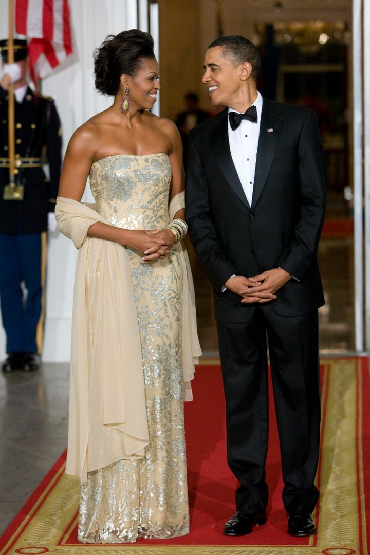 Dazzling in Naeem Khan at the Obamas' first state dinner in 2009. The dinner honored India's Prime Minister Manmohan Singh and his wife, Gursharan Kaur.