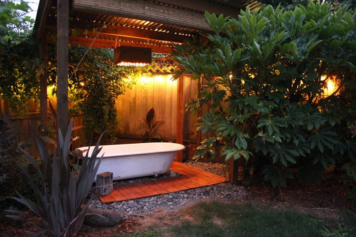 An outdoor bathtub is perfect for nighttime relaxation.