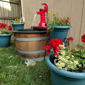 Rework a wine barrel into an outdoor water pump.