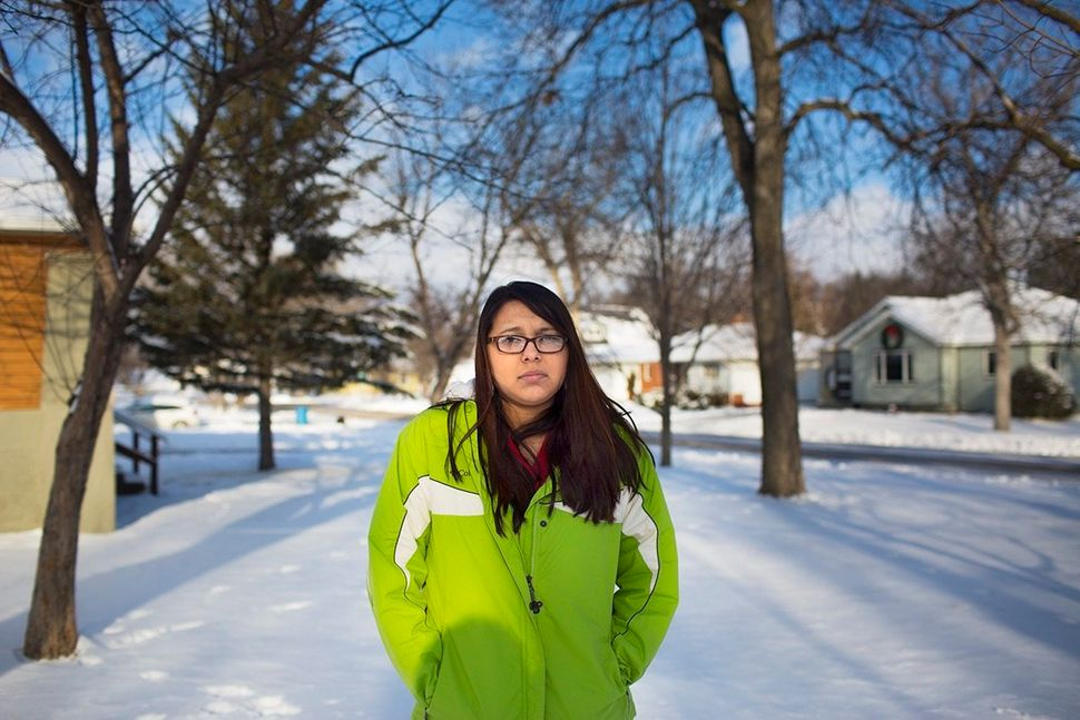 As she<strong>    </strong>ran toward her house<strong>, </strong>Native American Karissa was shot three times in the b