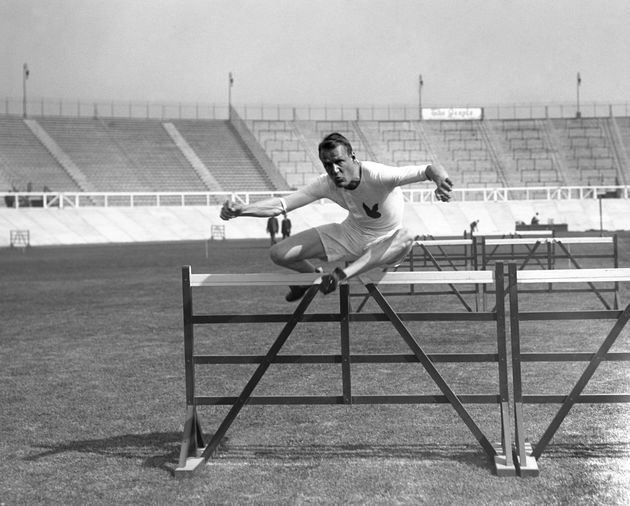 Hurdles or fencing? Canada's Frank Savage during the heats of the 110 metre hurdles during the 1908 London