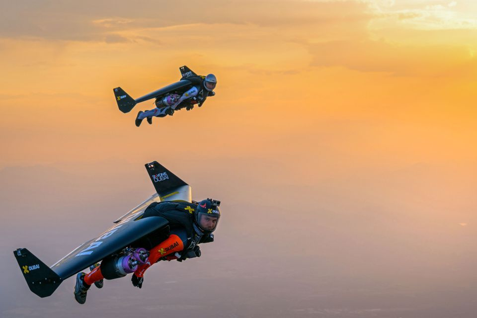 Pilots Yves Rossy and Vince Refeet fly at 17,000 feet in the