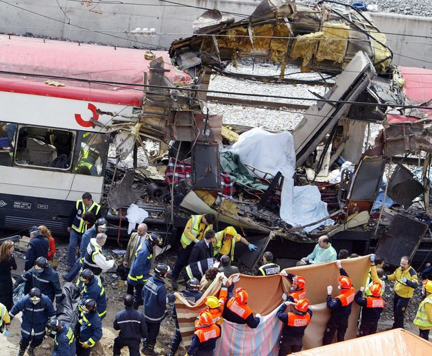 Photo taken 11 March 2004 of emergency services at the scene of the Madrid train bombing