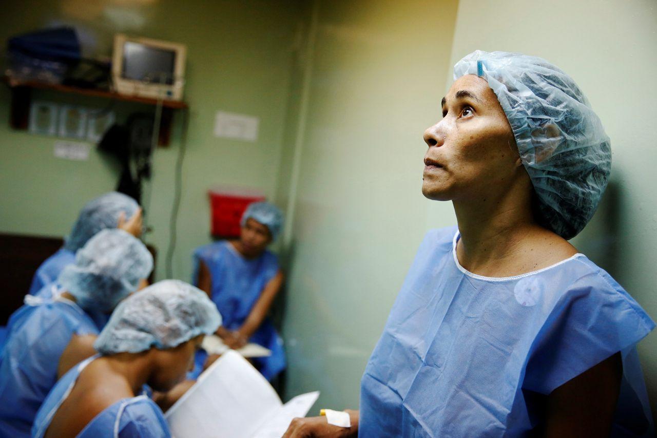 A woman waits for sterilization surgery a hospital in Caracas, Venezuela on July 27, 2016.