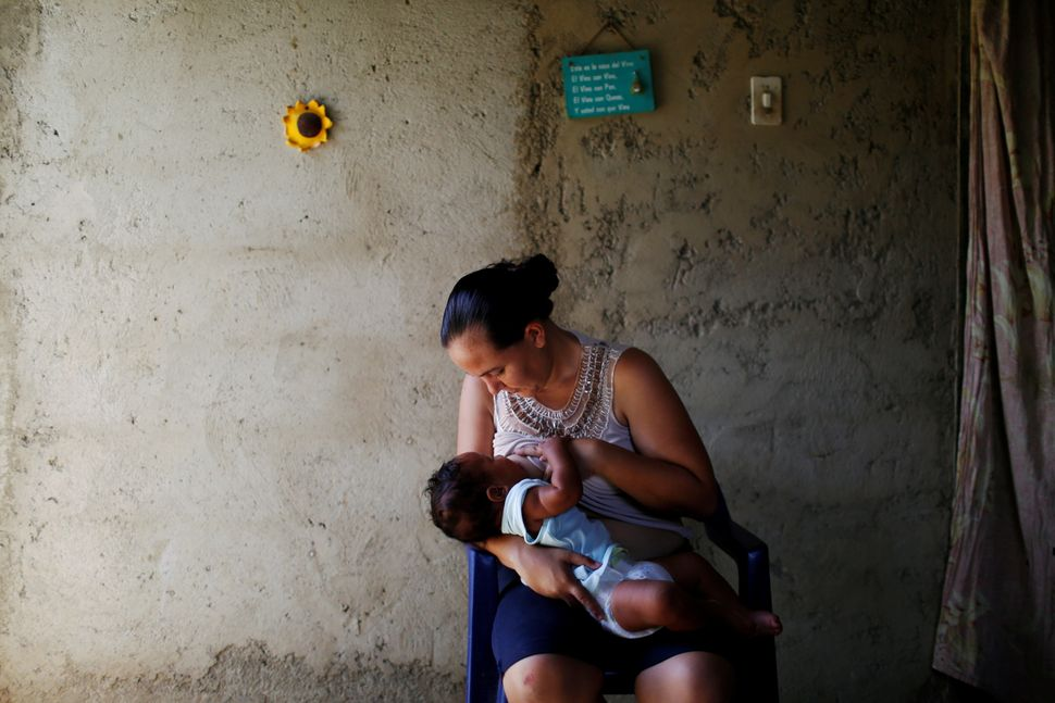 Emileidy Ojeda, 26, breastfeeds her four-month-old son David, ahead of her sterilization surgery, at their house in San Franc