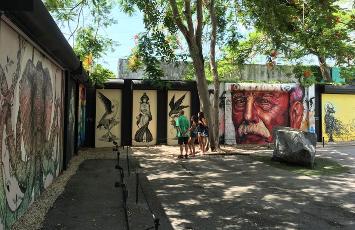 Tourists visit the Wynwood Walls, a popular outdoor graffiti exhibit that also falls in the approximately one-mile area where Florida Governor Rick Scott and state health officials announced local Zika transmissions inMiami, Florida, in July 2016.