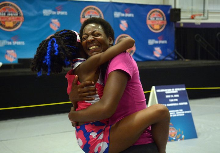 Rainn Sheppard shares a hug with her mom, Tonia Handy, who surprised Rainn by showing up to watch her compete in the Girls 30