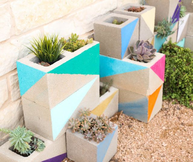 Decorated cinder blocks make for a colorful home for plants.