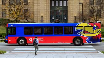 A bus passes in front of Strong Hall, an administrative building, Monday, Nov. 16, 2015 on the University of Kansas campus in Lawrence, Kan. As protesters sought and won leadership change at the University of Missouri last week, students on the University of Kansas campus 165 miles west were continuing their own months-long effort to shift focus to what they describe as a lack of support for minority students and a tolerance for racism. (AP Photo/Orlin Wagner)