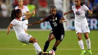 KANSAS CITY, KS - JULY 22:  Crystal Dunn of the United States controls the ball as Shirley Cruz #10 and Cristin Granados #15 of Costa Rica defend during the game at Children's Mercy Park on July 22, 2016 in Kansas City, Kansas.  (Photo by Jamie Squire/Getty Images)