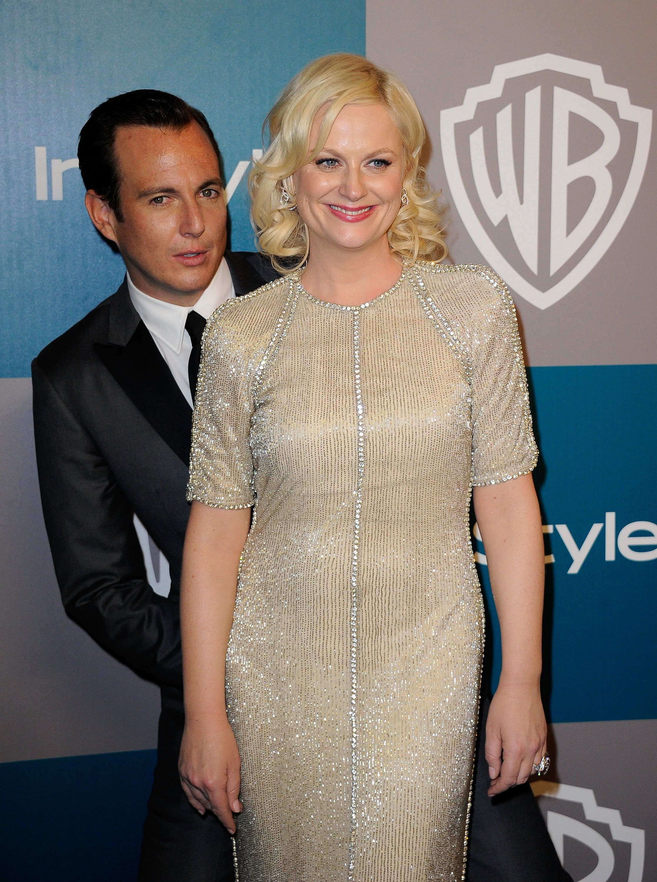 BEVERLY HILLS, CA - JANUARY 15:  Actors Amy Poehler and Will Arnett arrive at 13th Annual Warner Bros. And InStyle Golden Globe Awards After Party at The Beverly Hilton hotel on January 15, 2012 in Beverly Hills, California.  (Photo by Kevork Djansezian/Getty Images)