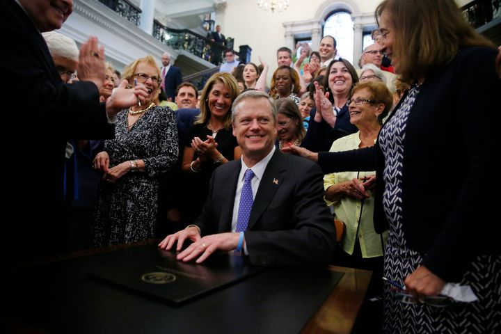The Republican governor of Massachusetts, Charlie Baker, signing the pay equity law on August 1 surrounded by some very happy