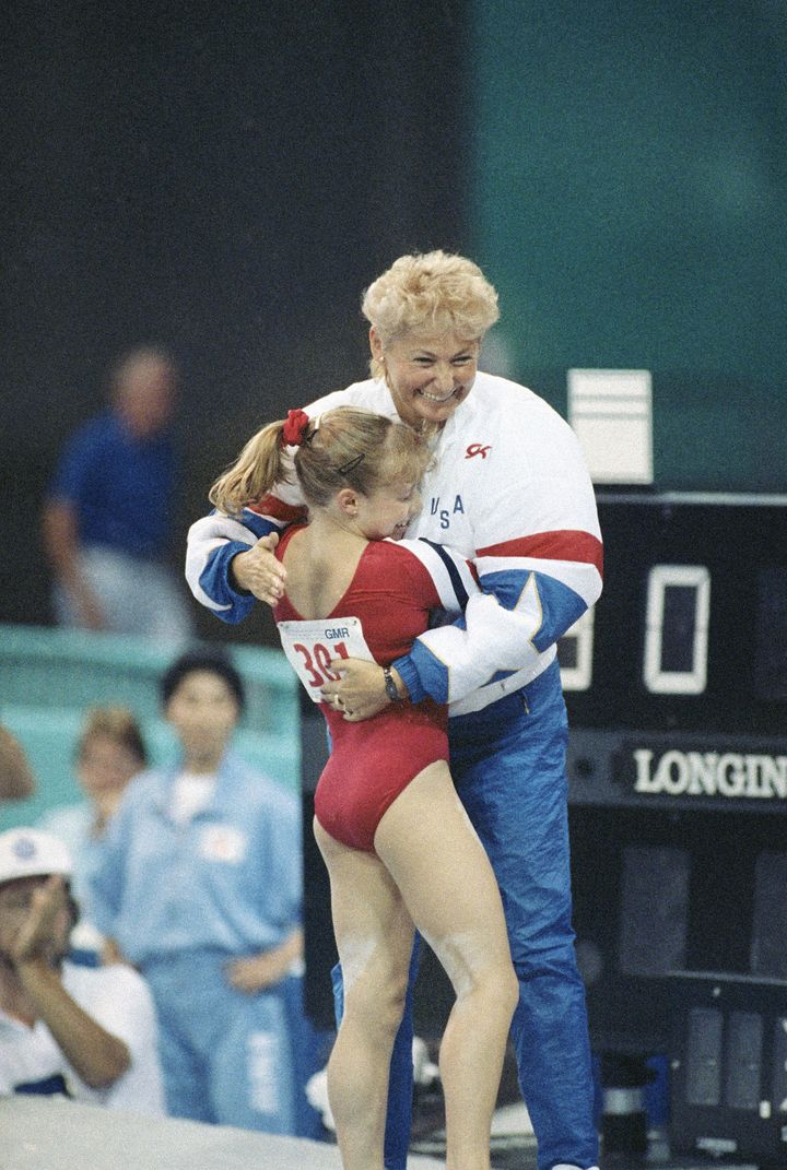 Kim Zmeskal and Martha Karolyi celebrate after Zmeskal finishes her bar routine at a 1990 meet.