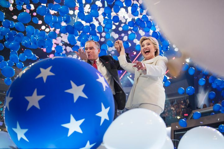 Democratic presidential nominee Hillary Clinton and her running mate, Sen. Tim Kaine (D-Va.), celebrate on the final night of