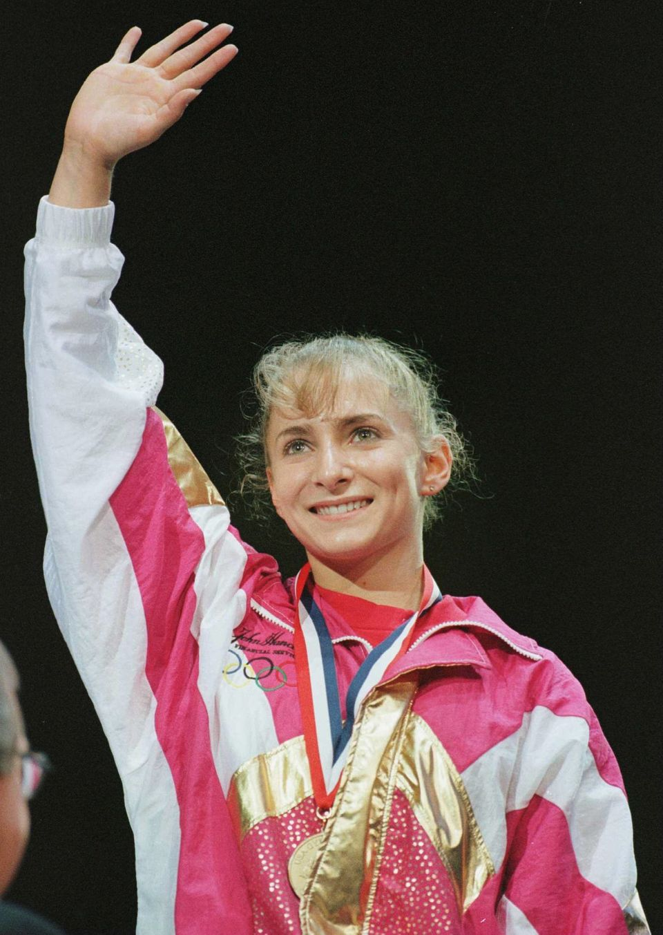 7 Jun 1996:  Shannon Miller waves from the podium after receiving the gold medal in the All-Around competition at the USA Gym