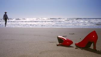 Woman and High Heels on Beach California USA