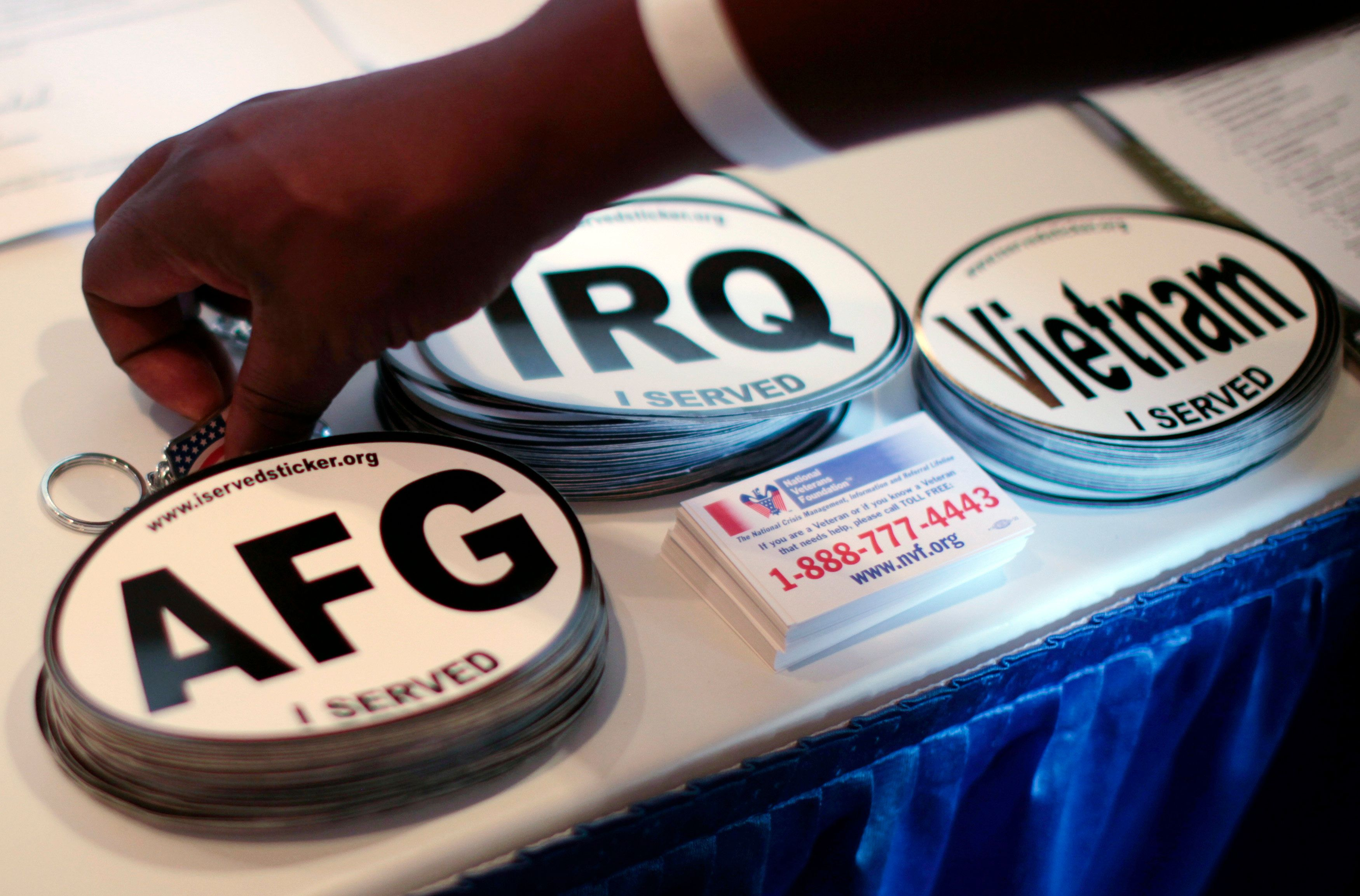Car stickers commemorating U.S. military service in Vietnam, Afghanistan and Iraq are seen on a recruiter's table at a veterans job fair in Los Angeles, California November 10, 2010. REUTERS/Lucy Nicholson (UNITED STATES - Tags: EMPLOYMENT BUSINESS)