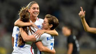 BELO HORIZONTE, BRAZIL - AUGUST 03:  Morgan Brian #14, Meghan Klingenberg #7 and Alex Morgan #13 of United States celebrate after Alex Morgan scores in the Women's Group G first round match between the United States and New Zealand during the Rio 2016 Olympic Games at Mineirao Stadium on August 3, 2016 in Belo Horizonte, Brazil.  (Photo by Pedro Vilela/Getty Images)