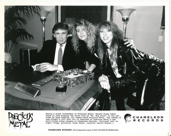 """Donald Trump seated next to Janet Robin (guitarist) and Leslie Knauer (vocalist) of Precious Metal. Courtesy <a href=""""http://"""