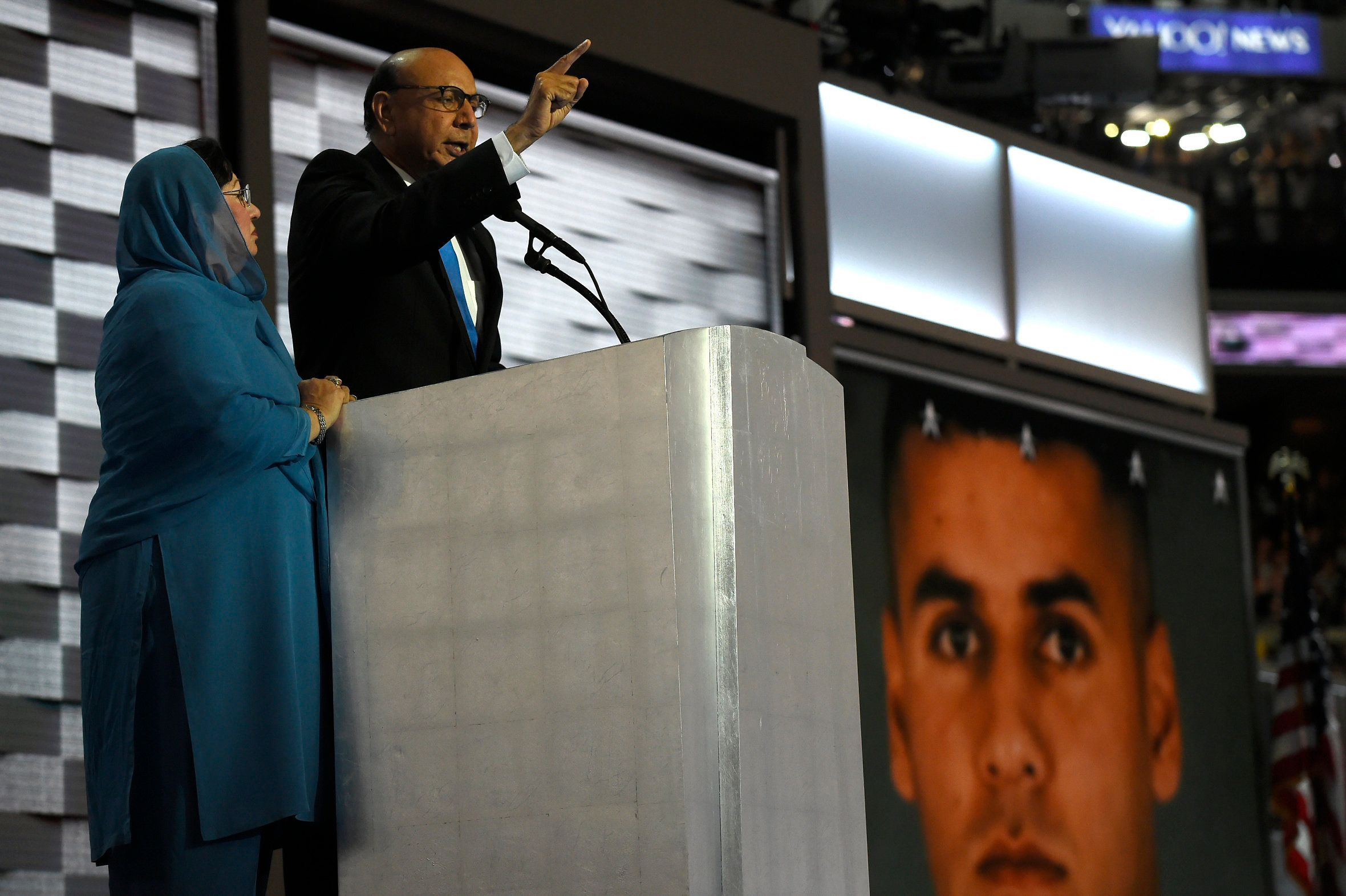 PHILADELPHIA, PA - JULY 28: Khizr Khan delivers a speech with his wife Ghazala Khan standing next to him at the Democratic National Convention in Philadelphia on July 28, 2016. An image of their fallen son, U.S. Army Capt. Humayun Khan, who was killed in Iraq in 2004 is shown on a video screen behind them. Donald Trump said that Ms. Khan had 'nothing to say.'  (Photo by Michael Robinson Chavez/The Washington Post via Getty Images)