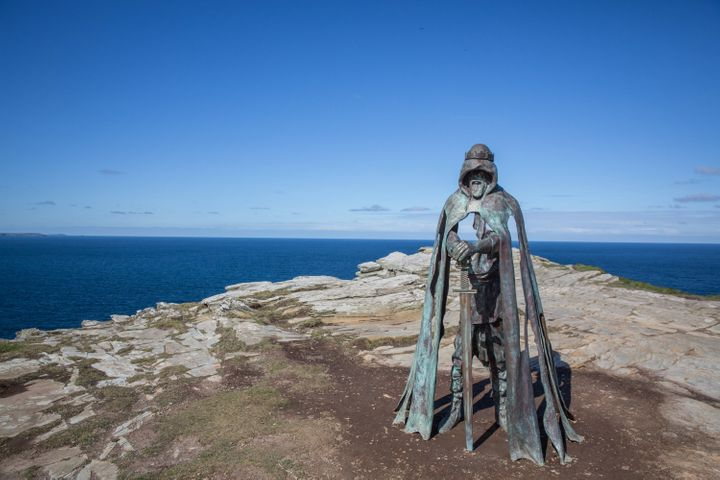 """The """"Gallos"""" sculpture at the site ofTintagel Castle. Legend has it that King Arthur was born at the site, andarc"""