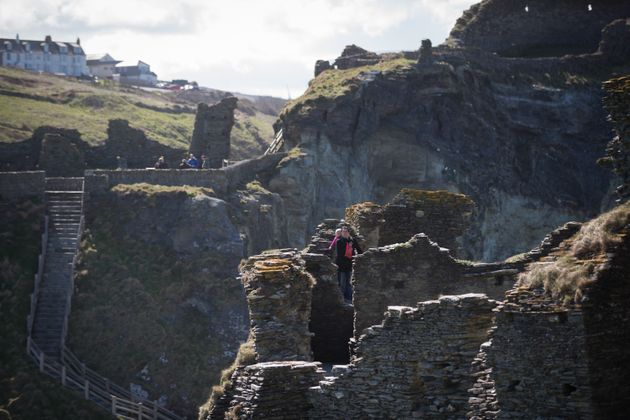 Tourists explore the ruins of Tintagel
