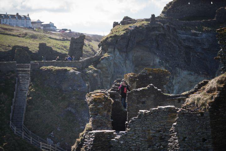 Tourists explore the ruins ofTintagel Castle.