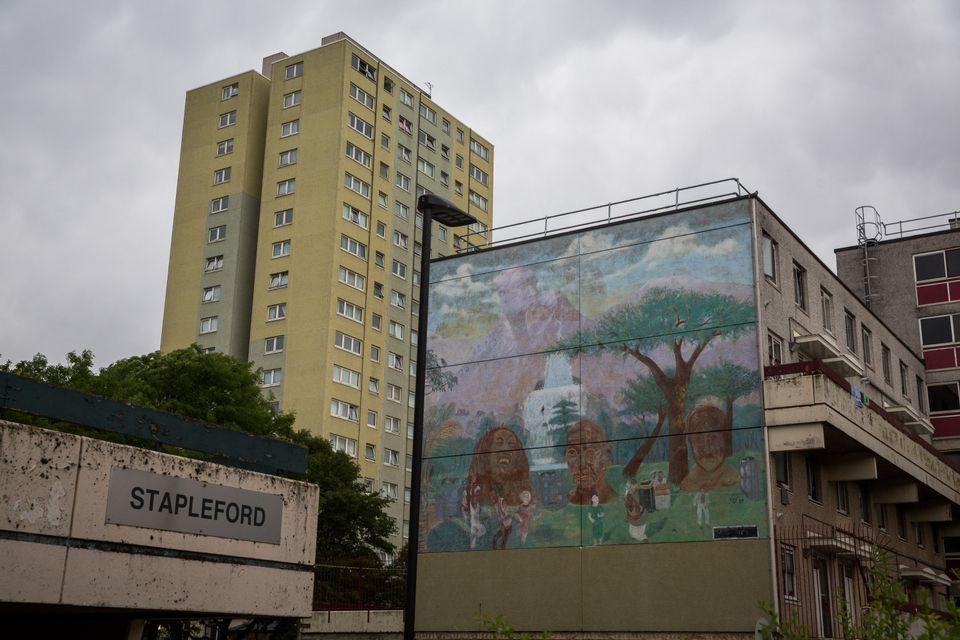 A mural showsBob Marley, John Lennon and