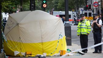 LONDON, ENGLAND - AUGUST 04: Police officers inspect the scene of a knife attack in Russell Square on August 4, 2016 in London, England. Six people were attacked by a 19 year old man with a knife at 10.30pm in Russell Square, London last night. A woman died of her injuries. The suspect was arrested at the scene and is being held at a London Hospital. Police say mental health issues are a significant factor but aren't ruling out terrorism. (Photo by Jack Taylor/Getty Images)