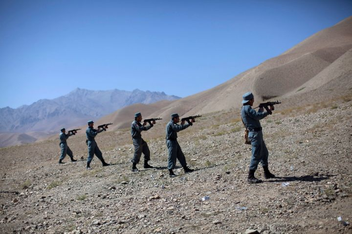 "Afghan policemen train at a live firing range in the central province of Bamiyan, which has <a href=""http://www.dailymail.co."