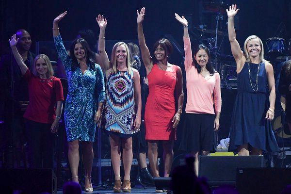 Kerri Strug, Dominique Moceanu, Jaycie Phelps, Dominique Dawes, Amy Chow and Amanda Borden (L-R) wave during the Parade of Ol