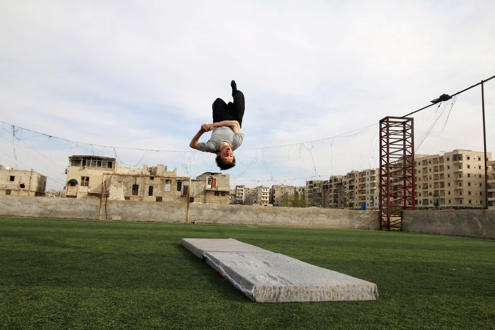 Syrian gymnast Ahmad al-Sawas practises in the rebel-held Bustan al-Qasr neighbourhood of Aleppo, Syria on March 23, 2016.