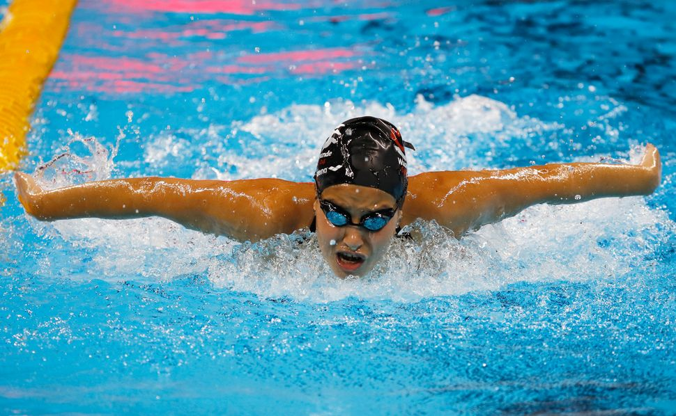 Syrian swimmer Yusra Mardini, 18, practices at the Olympic swimming venue. Mardini and another Syrian athlete will