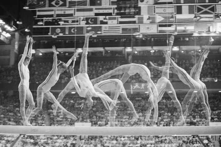Multiple exposure show's Romania's Nadia Comaneci on the balance beam,