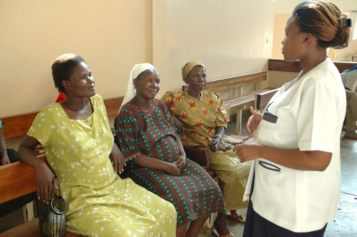 Pregnant women wait in the Maternity Child Health Clinic while the nurse talks to them about prenatal care. PATH, Program for
