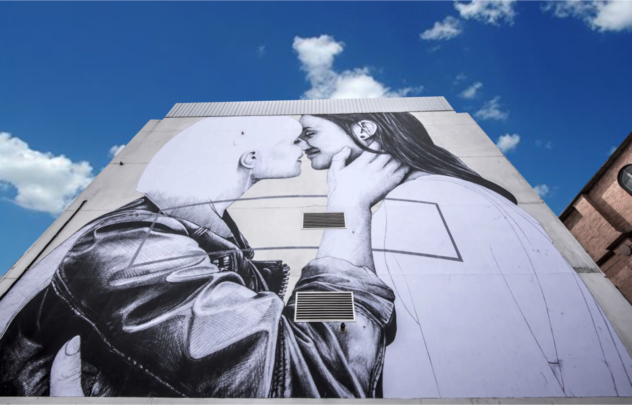 "The mural, titled ""Love Wins,"" is located on the side of a five-story building in downtown Belfast."