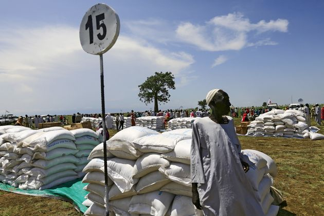 A man waits to receive food provided by the United Nations' World Food Programme (WFP) during a visit...